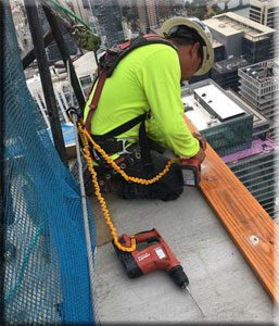 TFW Roofing Expert Working On 58 Story Busil